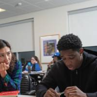 Two students work together on an assignment in class.